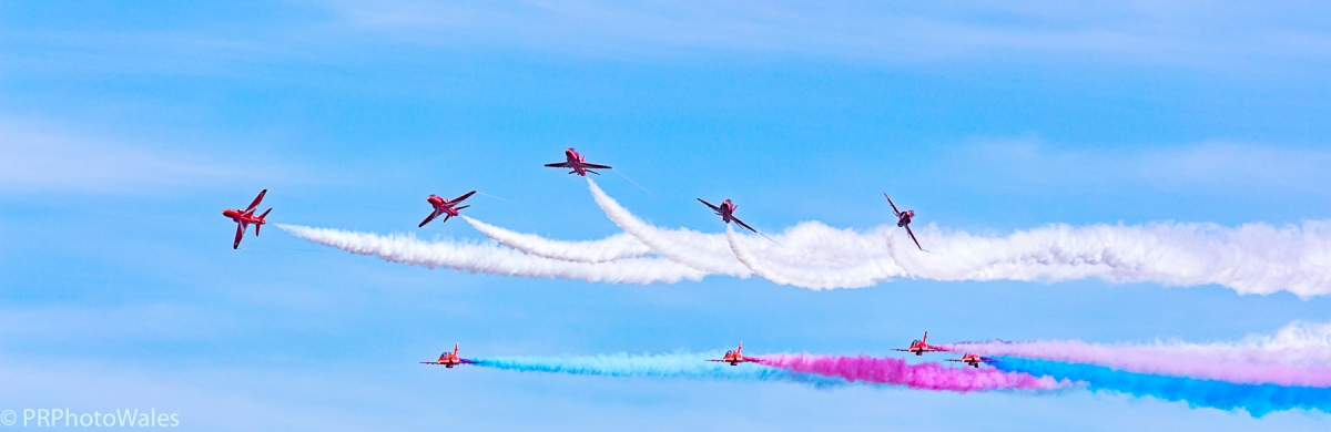 The RAF Red Arrows in formation just beginning 'Detonator' break, displaying at the Swansea Airshow 2017