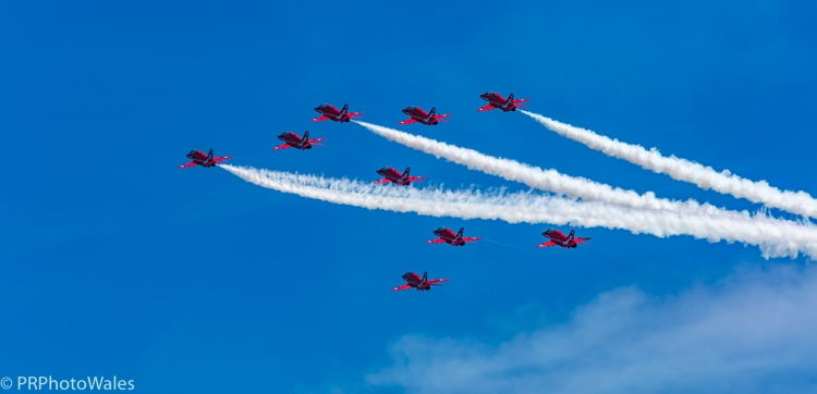 The RAF display team, the Red Arrows performing their thrilling aerobatic display at Swansea seafront on July 2nd, 2017. Here flying in formation, up and away to towards 11 o'clock. Three are trailing white smoke.